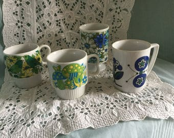 Four 1970s coffee mugs - blues and greens