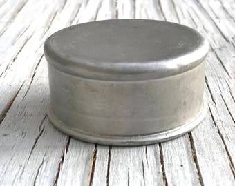 A vintage aluminum traveling cup, ingenious small metal opening cup. Closed size is 2.25 x 1 inch, 56 x 27mm.