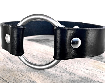Black leather choker with a large ring and snap closure