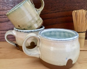 Three Stoneware Mugs (2 approx 8 oz, 1 approx 10 oz)