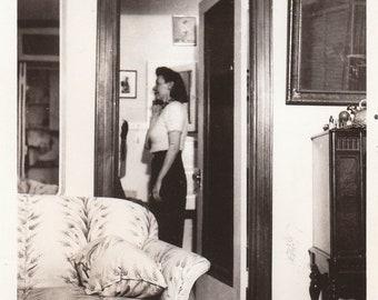Original Vintage Interior Photograph Snapshot WmoanStanding by Door 1940s-50s