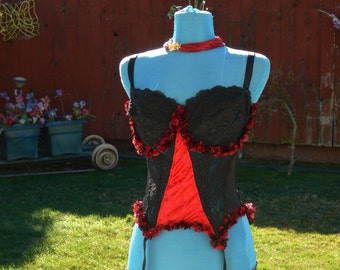 red and black boned  corset and garter size 40dd