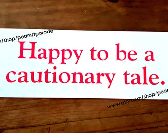 Happy to be a Cautionary Tale Bumper Sticker Peanut Parade Funny