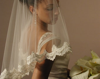 "Mantilla wedding veil. Mantilla fingertip length veil with Beaded pearls. Circular 42"" length. Made in USA"
