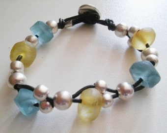 Womans leather bracelet with blue/yellow recycled indonesian glass beads