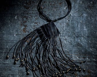 Flirty horn and leather statement necklace