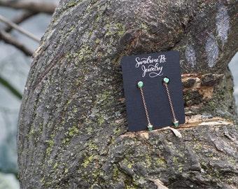 The dangle bullet cut earrings