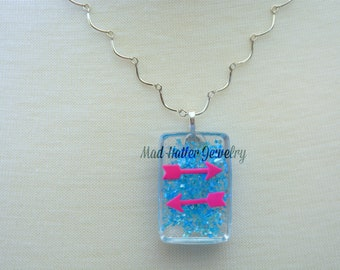 Pink Arrows and Blue Necklace