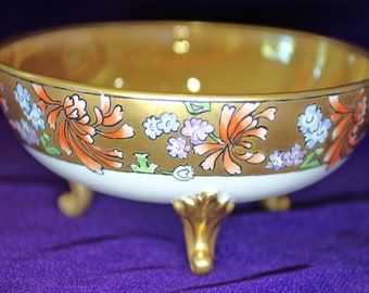Limoges, France; large, hand painted, Art Nouveau footed style bowl with luster interior.  Condition excellent to mint.