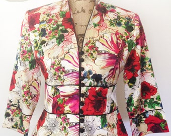 Vintage multicolor silk floral jacket with notched lapel. Bracelet sleeves and black cloth covered hoop fastened buttons. Size Medium