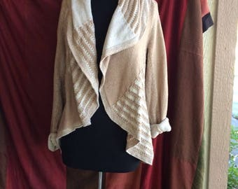 beige & white cardigan sweater with asymmetrical design synthetic fibers no buttons long sleeves very soft
