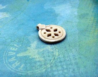 The Traveller Carved Bone Charm