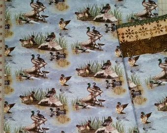 Wildlife pillowcase featuring ducks in water with brown trim at opening