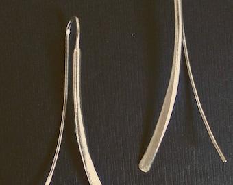 Ribbon look silver earrings