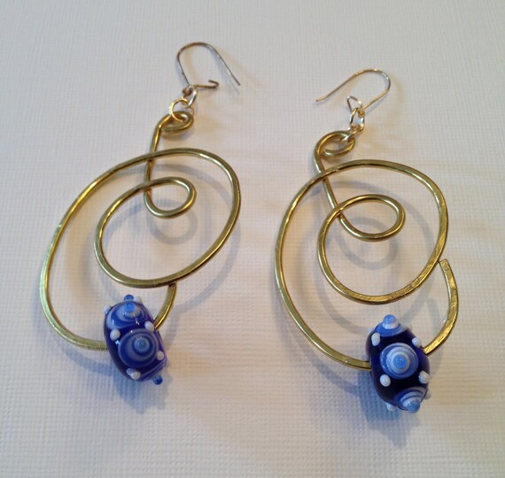 SJC10009 - Brass earrings with flattened wire work and blue glass bead with white spiral effects and white dots