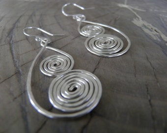 """Earrings... """"North Winds"""" handmade and hammered sterling silver wire earrings."""