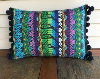 Pillow cover made from vintage textile with pom pom trim