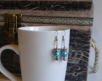 Unique silver and turquoise small dangling earrings, handmade by Felicianation