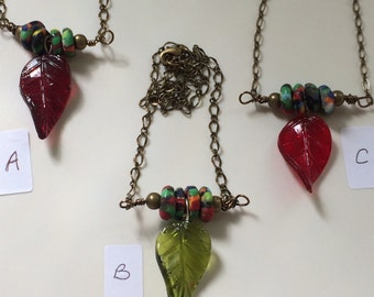 Colourful, recycled African glass necklace with coloured glass leaf pendant.