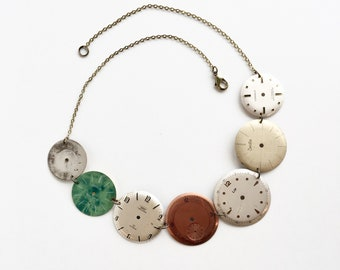 Necklace made with vintage dials from watches!