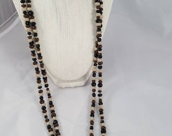 "30 "" shades of brown pearl necklace."