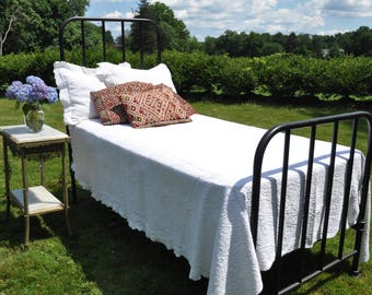 Antique iron twin bed