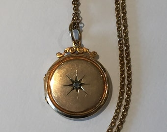 A Diamond Set Victorian Back and Front Locket and Chain