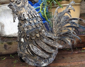Metal sculpture of a rooster
