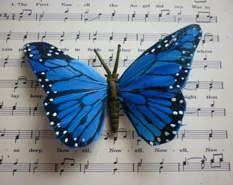 Decorative butterfly in blue and black paper to set for any ornament, sold individually.