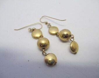 Vintage gold toned metal  dangling  pierced earrings used no markings