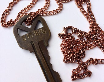 Custom stamped key necklace - SISTERS