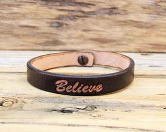 Leather Bracelet black with the word Believe, closed with a button in bronze, antique