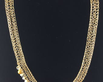 Gold handmade necklace with crystals and beads