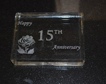 15 year Anniversary Crystal Paperweight Gift with Happy 15th Anniversary engraved on the paperweight.