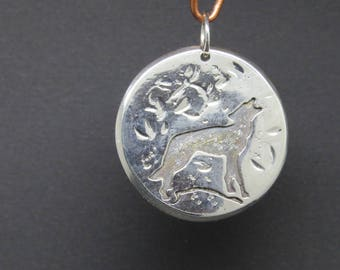Howling wolf pendant