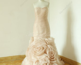 Blush fit and flare sequined wedding dress