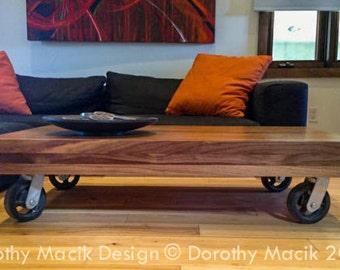Custom Strip Coffee Table from Reclaimed Wood on Industrial Wheels