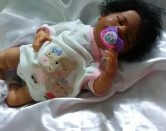 Biracial reborn baby