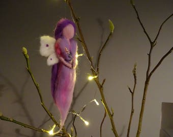 Here is Sparkle. She's made from fine soft merino wool. Waldorf inspired.