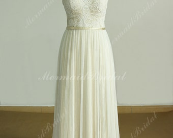 Open back a line lace wedding dress with pleated tulle skirt and champagne lining