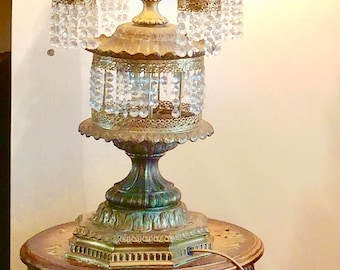 Antique pair of  Continental  gilt metal table lamps, each with four branches, suspended with chandelier, lights,crystal drops, throughout,