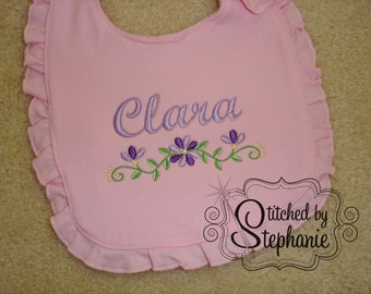 Personalized embroidered name purple floral border with name baby girl pink ruffled bib