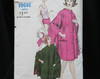 Size 10, Bust 31, Vogue 5843 one piece bathing suit, fitted, oval neck, low waist, and cape in two lengths with pockets, standing collar