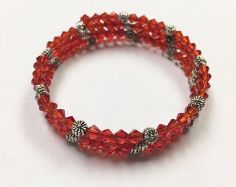 Red bicone floral bead memory wire bracelet