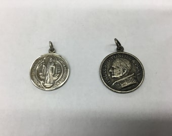 Set of 2 religious medals.  One is ,asked sterling