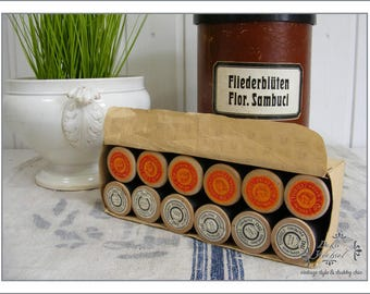 original box with old french yarn rolls