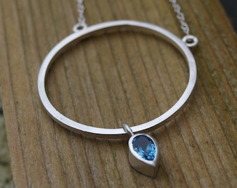 Large circle pendant, blue topaz necklace