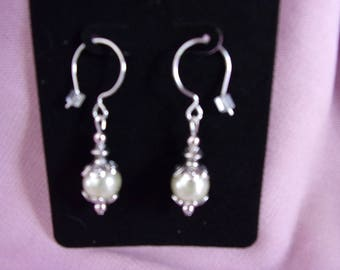 Pewter and cream colored pearl dangle earrings on sterling silver french wires