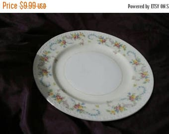 On Sale Homer Laughlin Georgian Pale Yellow Eggshell Nautilus  9.75 inch Dinner/Chop Plate with Pink and Pink Floral Design