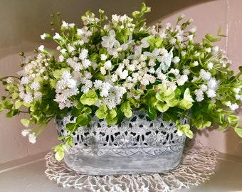 Boxwood and Baby's breath-floral arrangement in whitewashed metal container has a french country/shabby feel.